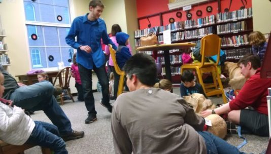Kids read to therapy dogs at RFL.